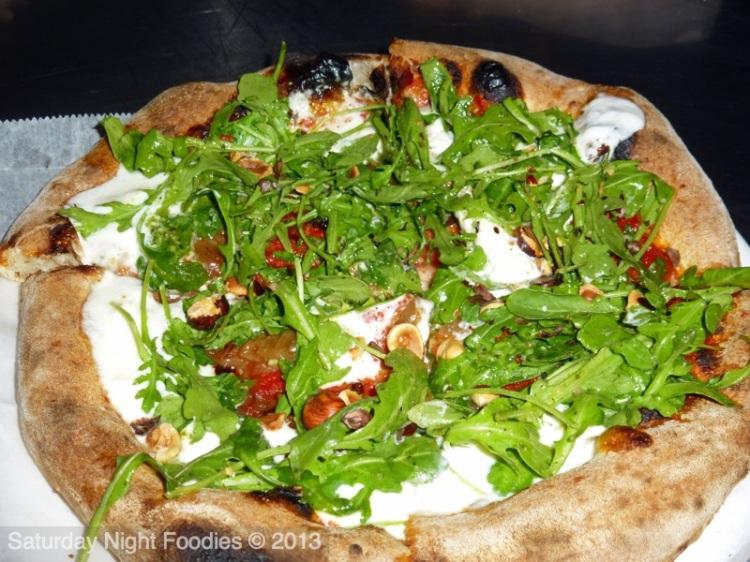 THE BURRATA PIE Burrata Cheese / Tomato Sauce / Wild Arugula / Caramelized Onion / Hazelnut / Pesto Drizzle